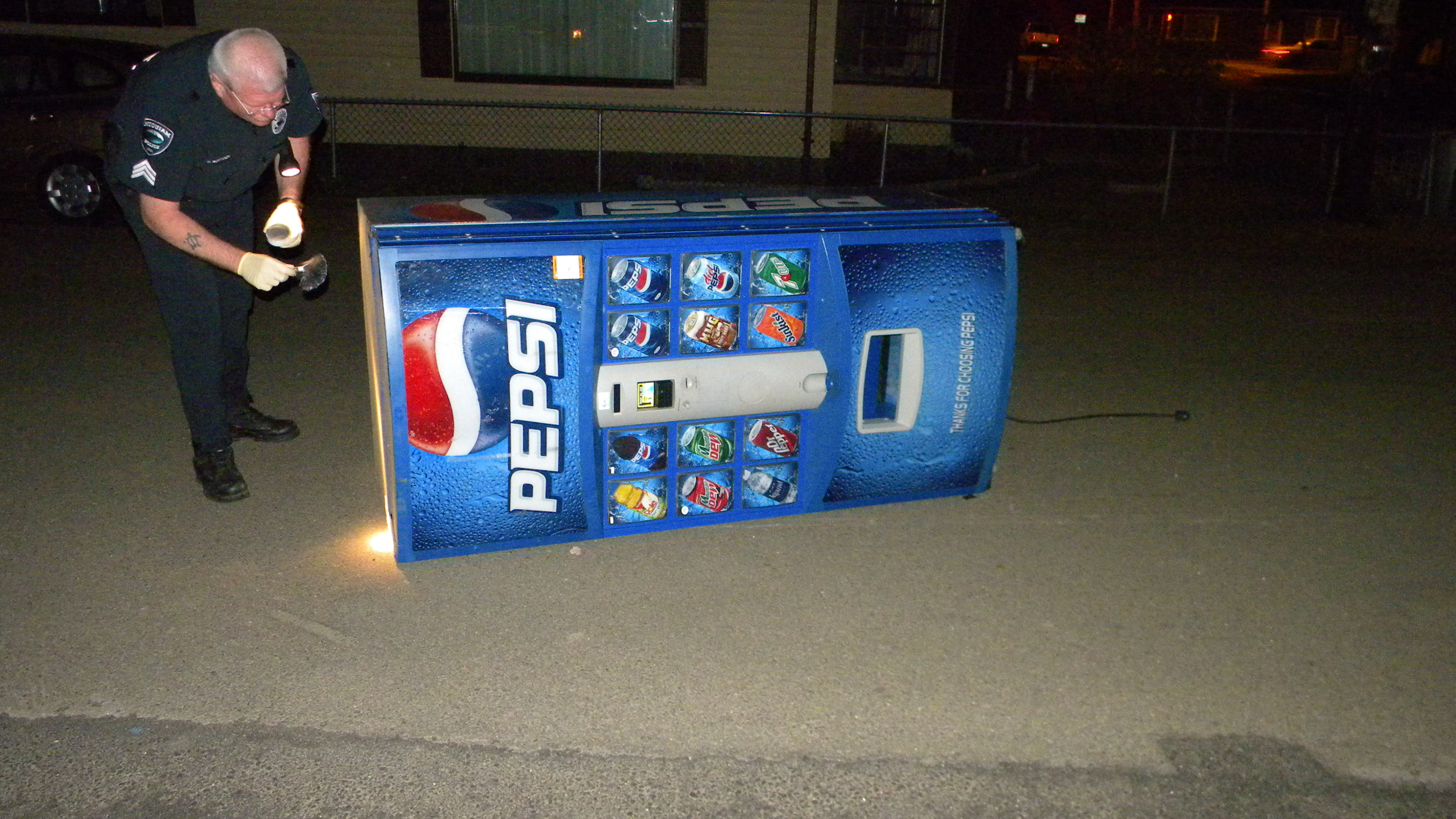 -Sgt. Wertanen processes the stolen Pepsi machine for latent prints