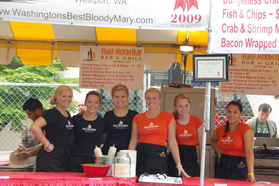The Half Moon Bay Bar and Grill pep squad kept the crowd entertained all weekend long at the Bite of Seattle while hawking fresh Dungeness Crab Cakes, Tuna Bombs, and Surf Melts.