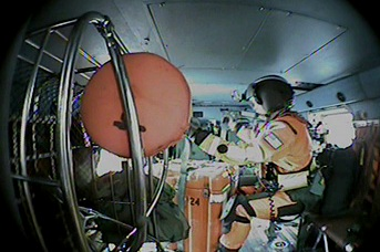 A Coast Guard Sector Columbia River MH-60 Jayhawk helicopter crew lowers a pump to a sinking fishing vessel off the coast of Washington State, Friday, Oct. 12, 2012.