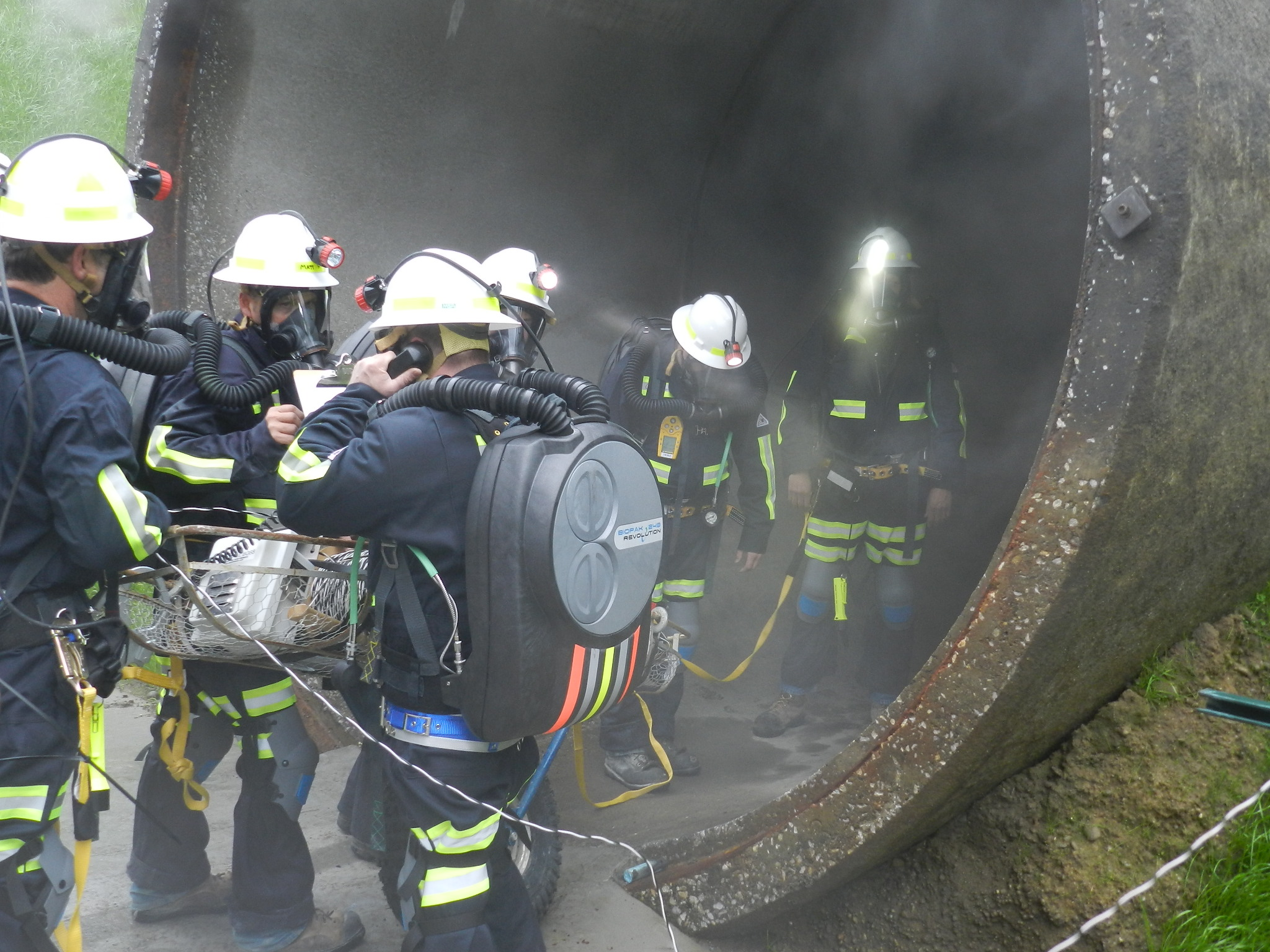 """Workers from contractor James W. Fowler Co prepare to enter a tunnel to """"rescue"""" their coworkers during a realistic training scenario at Satsop Business Park's new tunnel rescue training center."""
