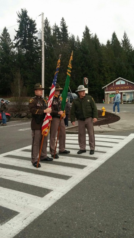 Sheriff Casey Salisbury speaks with Deputy Mondry and Deputy Baran as they get ready to march in the Belfair Christmas Parade.