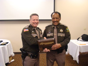 2.Sheriff Casey Salisbury on the left, awarding the 25 year service award to Deputy Sheriff Thurman Rankin on the right.