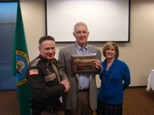 Sheriff Casey Salisbury on the left, awarding an appreciation award to OCCU Bert Fisher in the middle and OCCU Daris Devaney on the right.