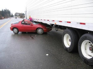 Driver slides under tractor-trailer near Central Park, closes State Route 12 Monday