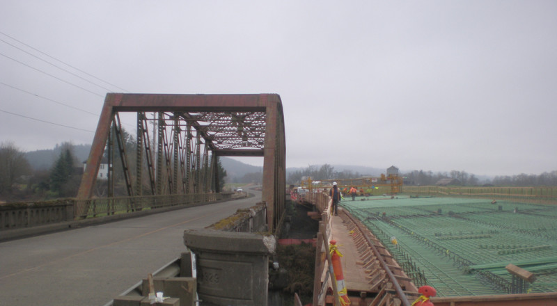 December 2013 - Pouring concrete for the new bridge deck.  Six weeks after setting girders, crews complete the rebar framework for the new bridge deck and start pouring concrete.