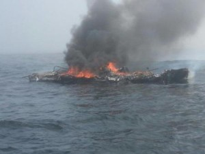 The 25-foot pleasure craft Dawn Trader is engulfed in flames following an engine fire three miles north of Neah Bay, Wash., Aug. 3, 2014.