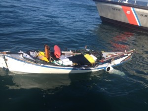 A 47-foot Motor Life Boat crew from U.S. Coast Guard Station Grays Harbor in Westport, Wash., inspects an unmanned 16-foot vessel about five miles northwest of Ocean Shores, Wash., July 31, 2014.