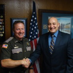 Sheriff Salisbury congratulating Officer Diaz after reciting the oath of office.