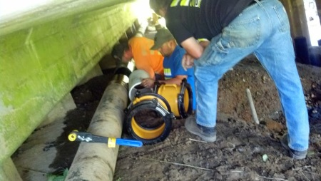 Cosmopolis City crews repair a broken water main under Main Street Thursday