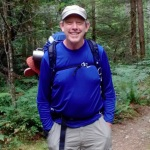 "Kelly Hall, 64 years old 6'5"", 220 pounds Overdue from six-day hike from Obstruction Point, to Grand Pass, Cameron Pass, Dose Meadows, Gray Wolf Pass. Planned to be picked up at Slab Camp Trailhead on USFS Road 2875 on Thursday September 4. • Blue backpack • Blue 'Mountain Hardware' stocking cap • Fishing pole and orange flip flops strapped to outside of pack • Believed to be using a blue-gray tent Anyone who has seen Hall since August 30, please call Olympic National Park at 360-565-3120."