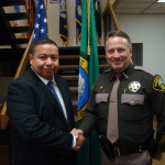 Newest members of the Mason County Sheriff's Office family,Officer Latch (red shirt) and Deputy Mercado (blue suit).