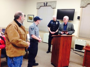 Hoquiam Mayor Jack Durney, Police Chief Jeff Myers and Explorer Tom Johnson