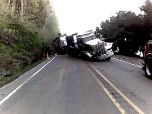 Truck drifts off roadway, throws debris into oncoming U.S. 101 traffic North of Shelton