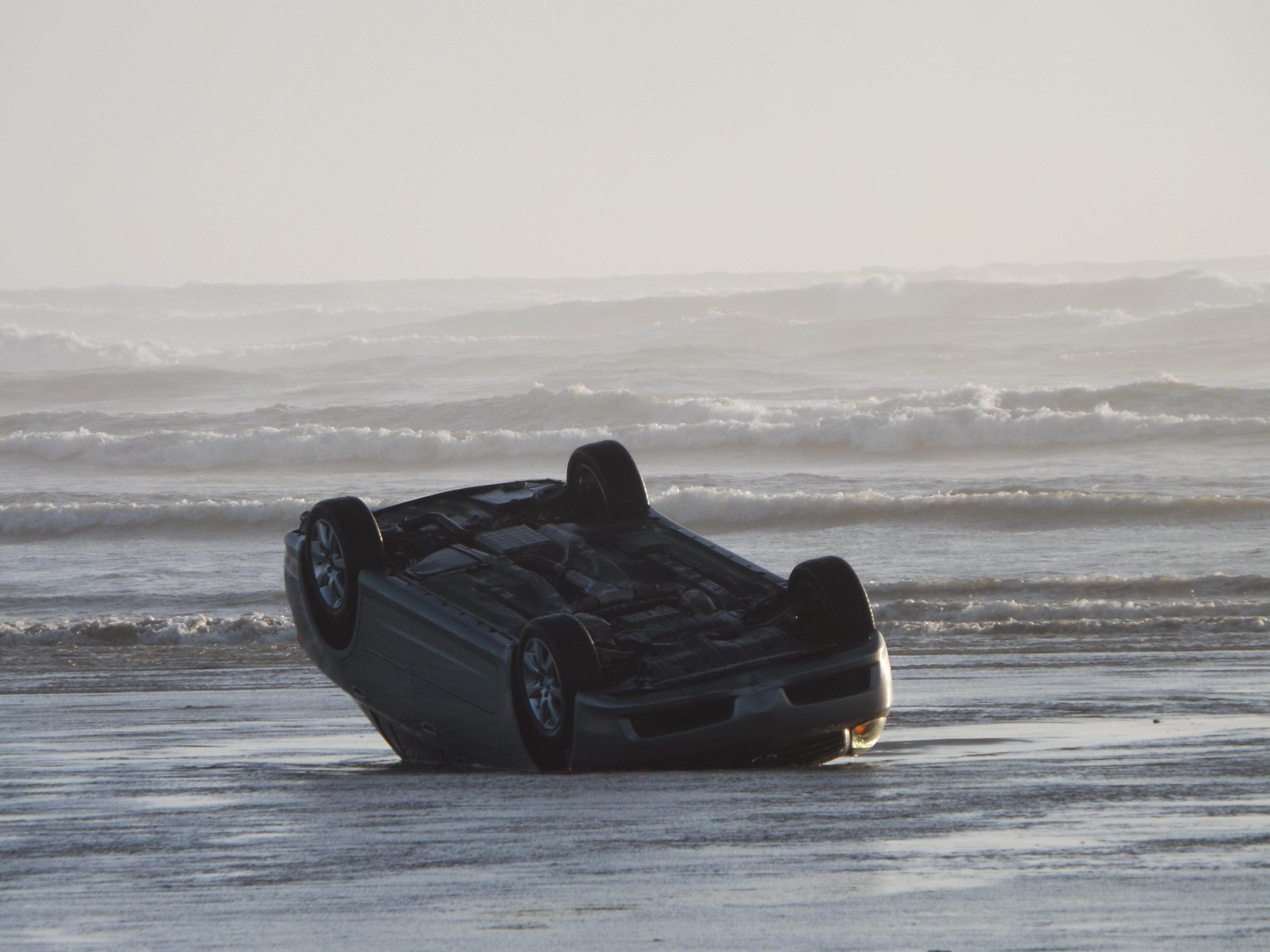 Family rescued from car on beach seconds before waves roll it over