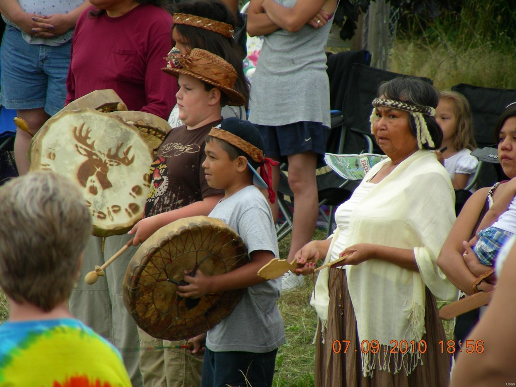 Members of the Swinomish Tribe, seen here at a tribal ceremony, are concerned that long trains of oil tank cars are crossing their reservation every week, a development the Tribe says violates its 1991 easement agreement with a rail company. Photo credit: Leslie Dierauf/U.S. Geological Survey.