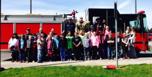 Auditing home smoke alarms nets Ocean Shores 3rd graders a pizza party with fire fighters