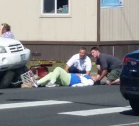 Woman injured after vehicle hits, high centers on electric wheelchair