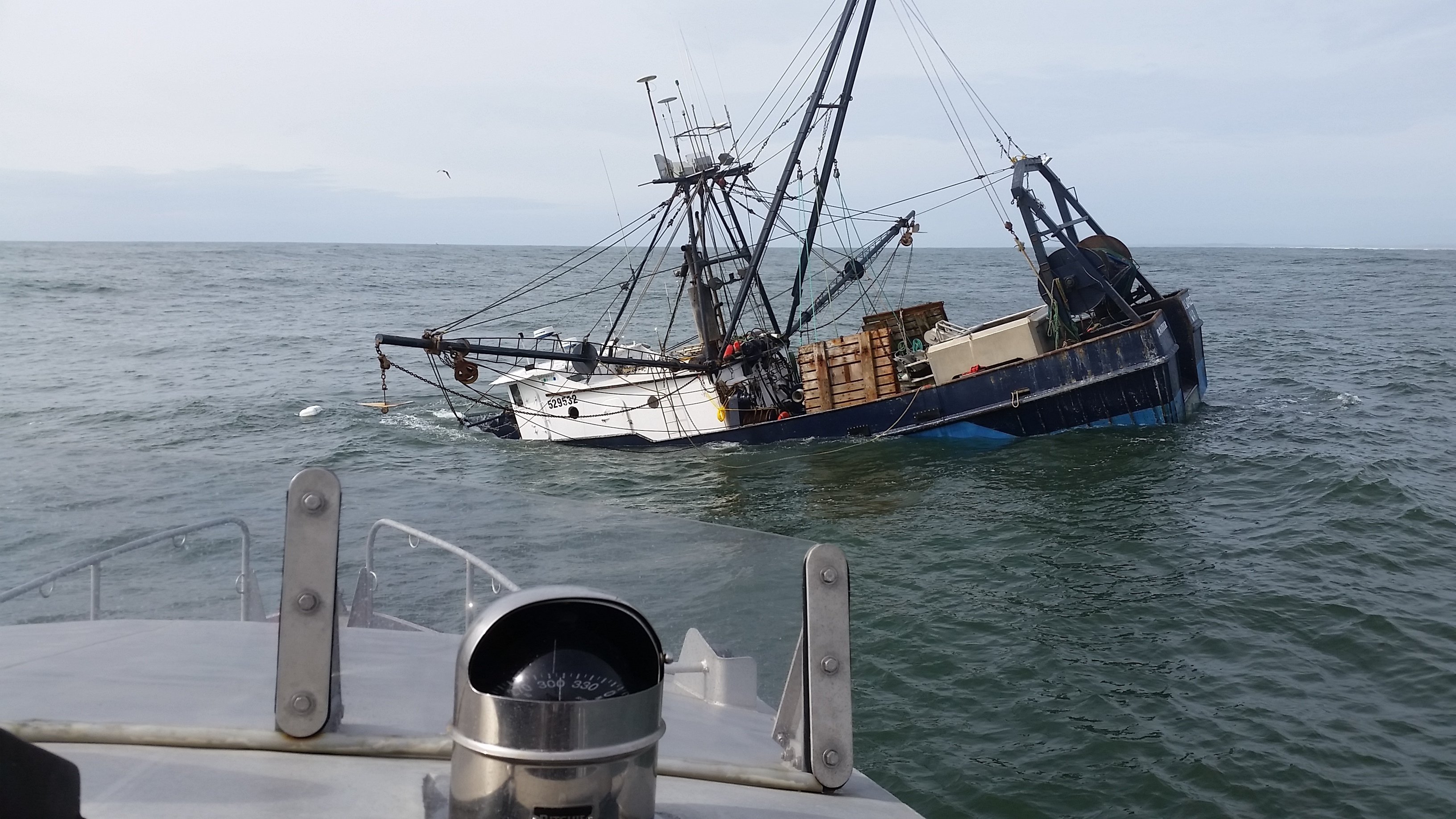 The 74-foot fishing vessel Privateer sinks approximately one mile north of Grays Harbor, Wash. April 15, 2016. The Oil Spill Liability Trust Fund was opened to assess the salvaging of the vessel, which was reported to have a maximum fuel capacity of 6,000 gallons. U.S. Coast Guard photo by Petty Officer 2nd Class Jacob Hylkema.