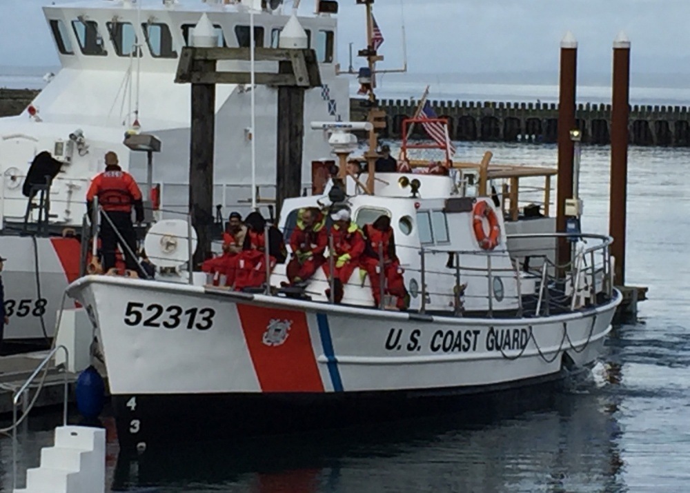 A Coast Guard Station Grays Harbor 52-foot response boat medium crew return to port after rescuing five fishermen off of their fishing vessel Taplow which sank 29 miles southwest of Grays Harbor, Wash., Oct. 7, 2016.  Although their boat was lost, all five fishermen returned to shore in good health.  U.S. Coast Guard photo by Chief Petty Officer Casey McDonald.