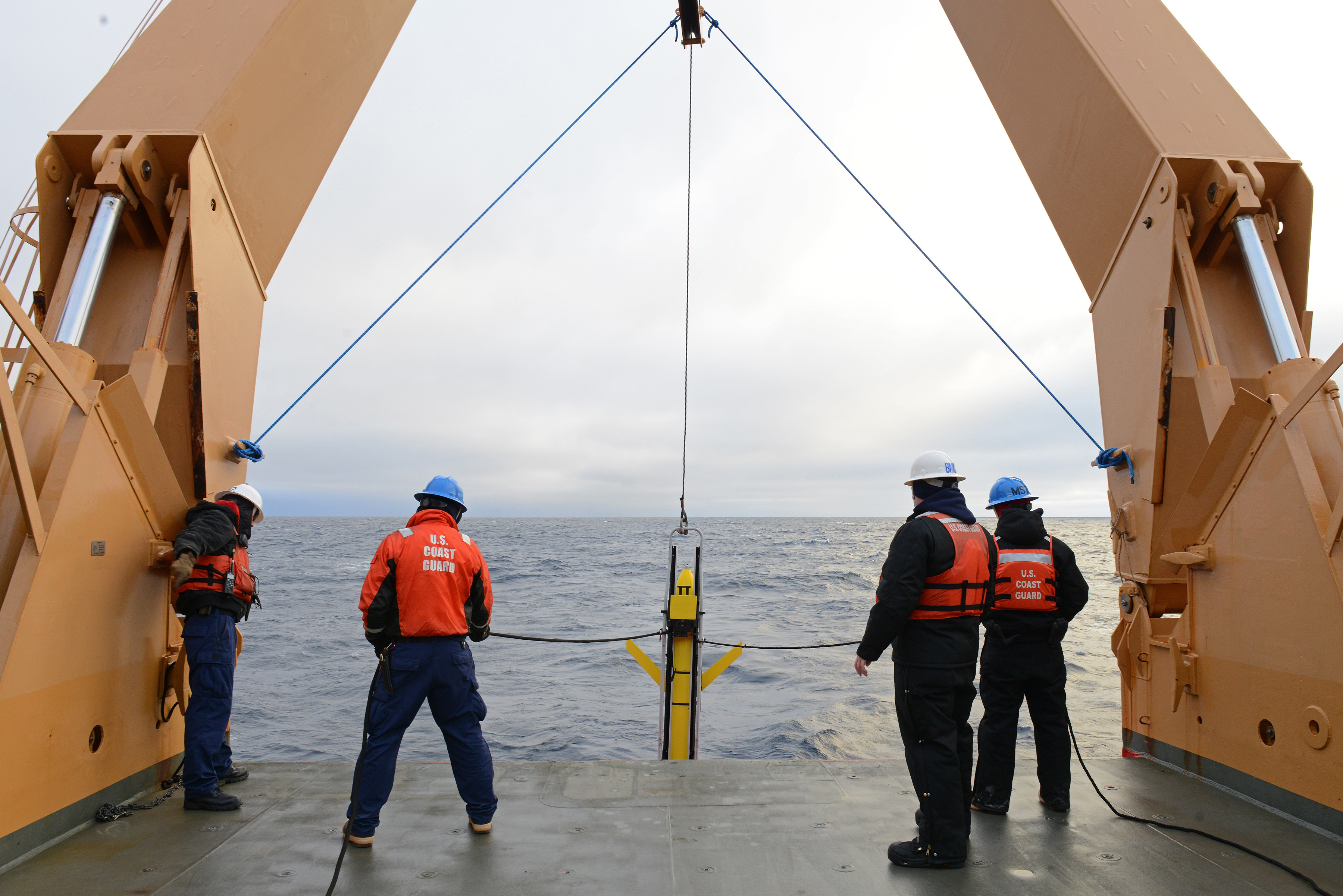 Crewmembers aboard Coast Guard Cutter Healy lower a Sea Glider into the Arctic Ocean on Sept. 20, 2016. The Healy has a multi-capable platform to fit deployments and recoveries of many different types and sizes of scientific equipment. U.S. Coast Guard photo by Petty Officer 3rd Class Lauren Steenson.